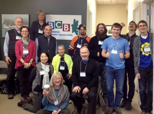 Many of BCB's adult and student volunteers gathered on Bainbridge Island at the new BCB studios in January 2015 to celebrate the new location near the High School.