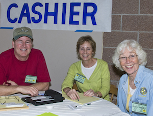 Here are three of the more than 1,100 volunteers who are the enthusiastic inside story of the annual Rotary Auction