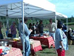 Earlier this year, Friends of the Farms hosted its annual meeting and potluck at the Day Road farms (see photo). The upcoming Farm-to-Table Dinner will occur on the site of the Farmers Market by City Hall.