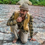 Landscape artist Jeffrey Bale pictured with one of his labyrinths.