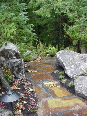 A peaceful rock resting point overlooking the Fairy Dell Ravine -- one portion of the last Japanese Garden designed by Junkoh before his death.