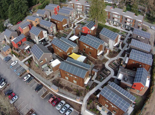 Solar panels at Winslow's Grow Community (in photo above) were joined on Earth Day (April 22) by a solar rooftop at Waterfront Community Center. Grow Community has solar on 100% of its homes and has won several awards for green building.