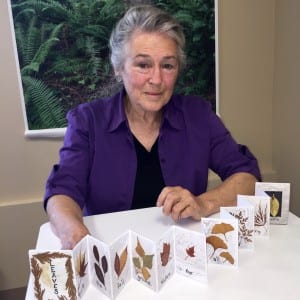 "Susan Callan with her ""Leaves"" collection in the form of an accordian-style artist's book"