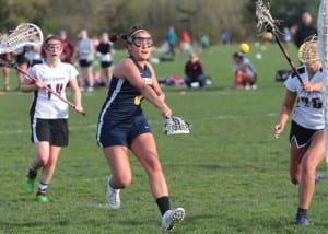 Sonia Olson shoots a goal in a game last year against Holy Names. (Photo credit Inside Bainbridge)