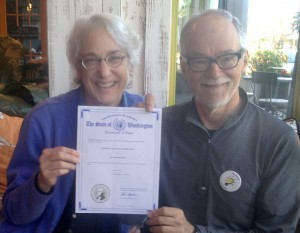 Jane Lindley and Steve Johnson display Island Power's nonprofit certificate in early 2015
