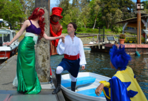 "The costumed cast of BPA's ""Little Mermaid"" are seen here at the City dock in Waterfront Park (Photo Credit: BPA)"