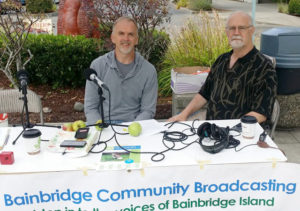 Darren Murphy, left, of the BI Fruit Club, chats with BCB Tech Chris Walker at the Farmers Market.