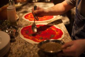 Preparing a classic Neapolitan pizza. Photo courtesy of Bruciato.